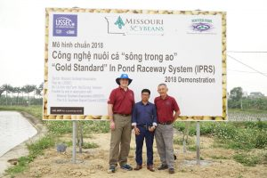 Standing with Mr.Viet, the farmer/cooperator for the USSEC/MOSOY IPRS demonstration in Vietnam